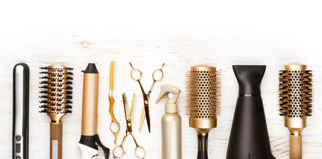 Hair Cut, Color, and Style Services, hair cutting tools arranged in a line