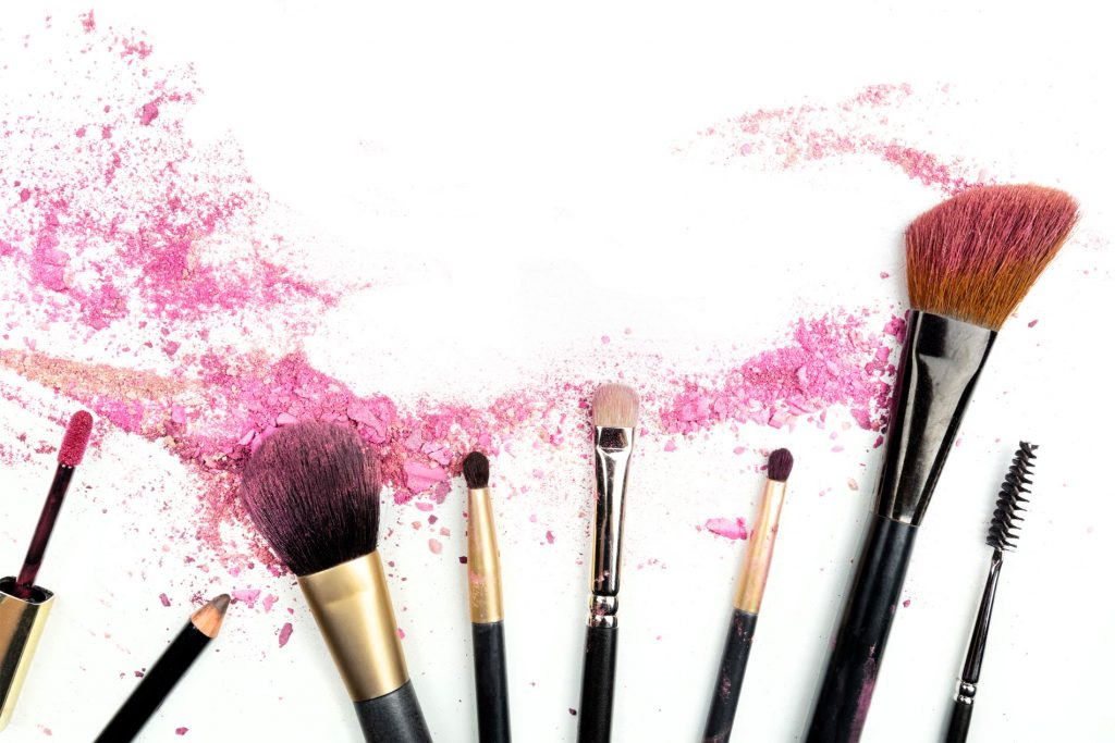 Austin TX Makeup Services, Makeup brushes fanned out over a white background